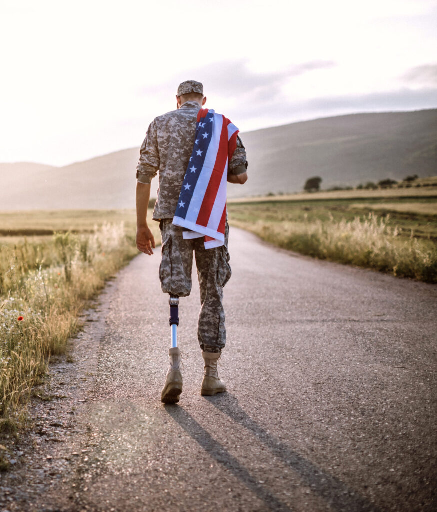 american-soldier-with-prosthetic-leg-working-in-his-office